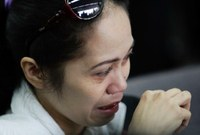 Philippines: A Filipino overseas worker, who just arrived from Syria, weeps after arriving at airport in Pasay City, Metro Manila